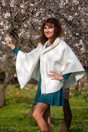 outerwear: View of a beautiful woman with fashion clothing on the countryside. Stock Photo