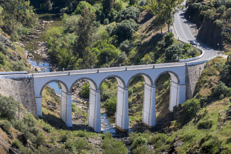 region of algarve: View of an amazing old arch bridge on the town of Mertola, Portugal. Stock Photo