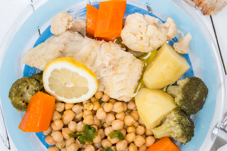 Portuguese meal, Codfish with chickpeas and vegetables. Banco de Imagens
