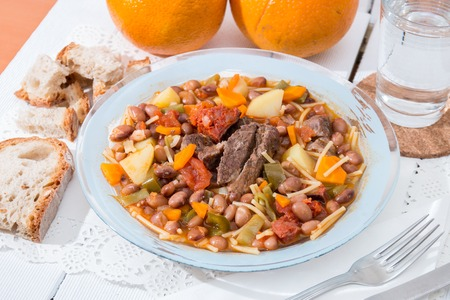 Portuguese meal, Brown beans with meat and carrot.