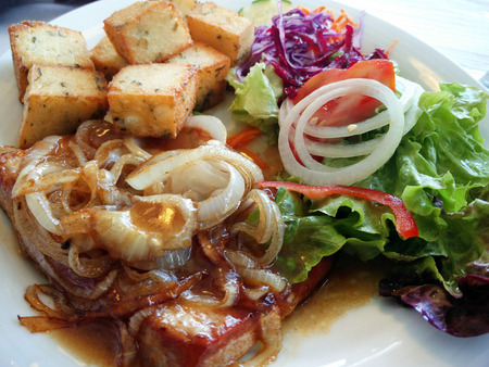 Portuguese meal, tuna fish with onions, potatoes and salad, typical of the island of Madeira.