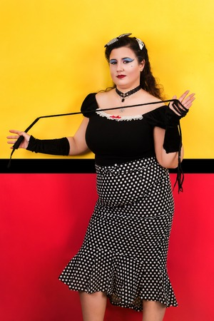 View of pinup vintage girl next to a colorful pop art backdrop.