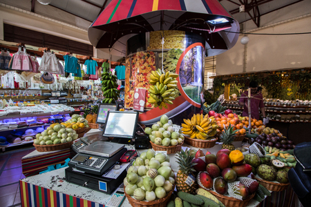 Variety of exotic fruits at sale on the market. Editorial