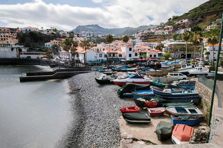 Traditional fishing boats on the shoreline of Camara de Lobos village, Madeira.