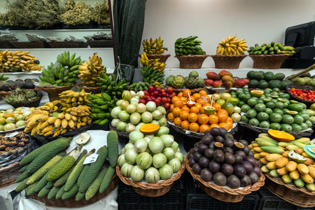 Variety of exotic fruits at sale on the market. Stock Photo
