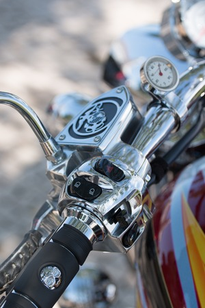 Close view detail of the shiny details of a classic motorcycle.
