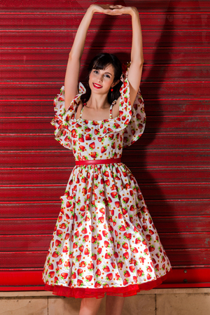 Woman posing with a vintage style retro floral clothing. Stock Photo
