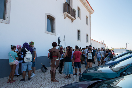 anime young: FARO, PORTUGAL - August 19, 2017: Visitors in line to enter the event Manga & Comic Event.