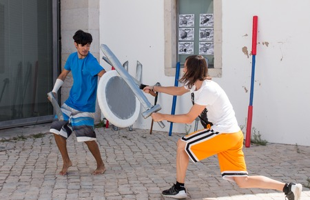 FARO, PORTUGAL - August 19, 2017: Nerd sword and shield fighting in the Manga & Comic Event. Editorial