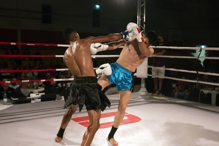 Kickboxer in the ring fighting another athlete.