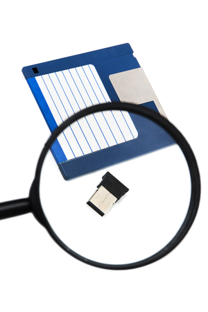 hand with magnifying glass inspecting on usb disk concept. Stock Photo