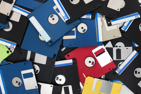mixed pile of obselete computer floppy disks.