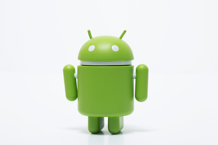 OLHAO, PORTUGAL - 6th november, 2017 - Famous Android mini collectible figure, that represents the mobile operating system developed by Google isolated on a white background. Editorial