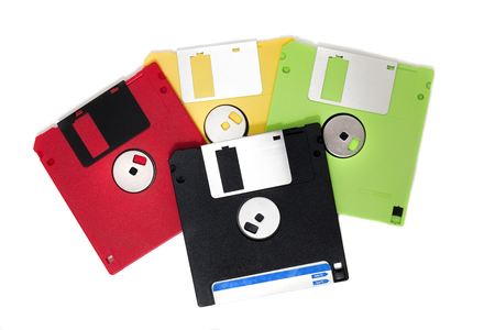 colorful computer floppy disks on a composition isolated on a white background.
