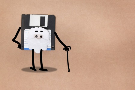 animated floppy disk concept, stick and walk figure.