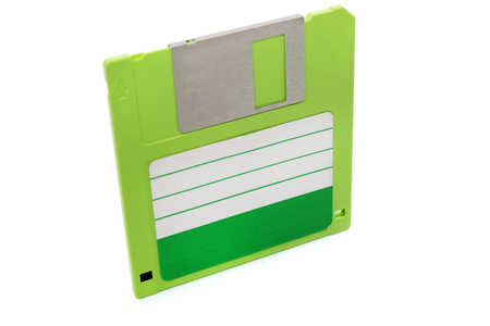 green computer floppy disk,  isolated on a white background.