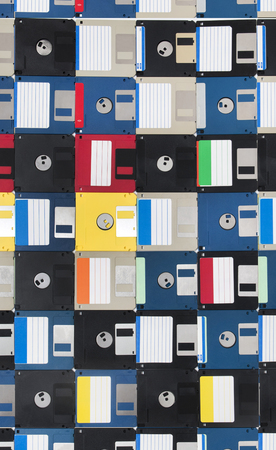 Full view of a background of many colorful floppy disks.