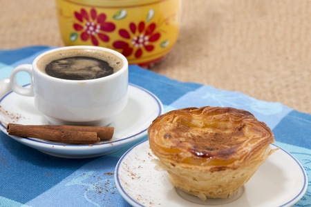 Typical Portuguese breakfast with expresso coffee and egg custard pastry. Stock Photo