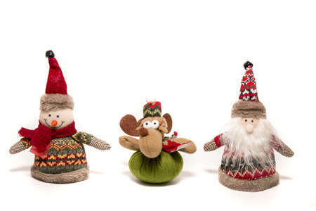 Stuffed Christmas themed toys isolated on a white background.