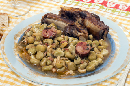 Homemade portuguese faba beans meal with bread and wine.