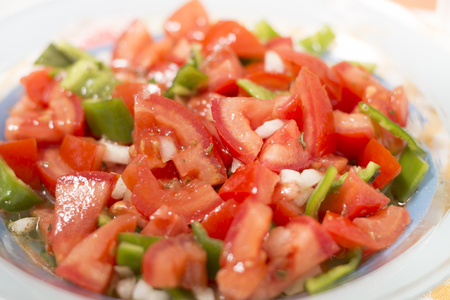 Fresh tomato and bell pepper salad typical of Portuguese cuisine.