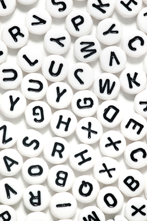 Plastic beads with letters isolated on a white background. Stock Photo