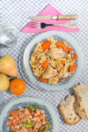 Typical Portuguese meal of Chicken with carrot and spaghetti.