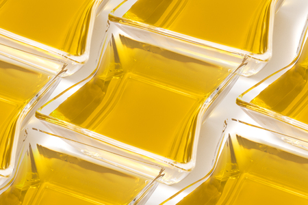 Aligned olive oil glass container  concept. Stock Photo