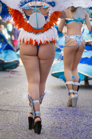 Legs of a colorful Carnival (Carnaval) Parade festival female participant