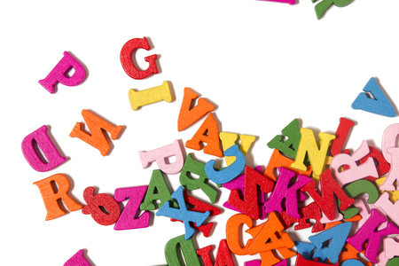 Wooden colorful letters isolated on a white background.