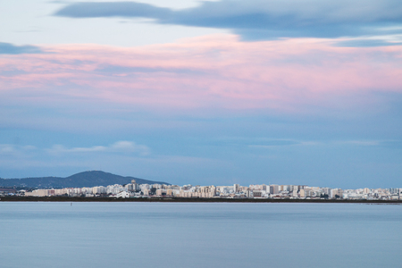 Beautiful view of the city of Faro, Portugal, viewed from far away.