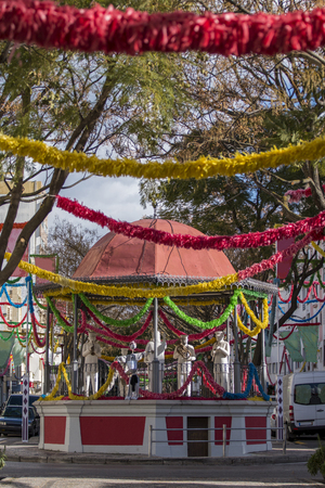 Outdoor view of the main avenue bandstand of Loule city with carnival decoration.