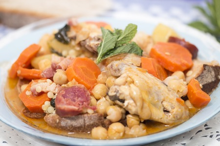 Traditional portuguese meal of Chickpeas with chicken, carrot and chorizo.