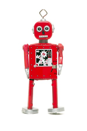 Vintage retro red tin toy robot isolated on a white background. Banco de Imagens