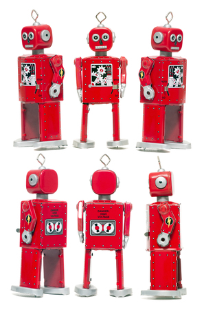 Vintage retro red tin toy robot isolated on a white background. Stock Photo