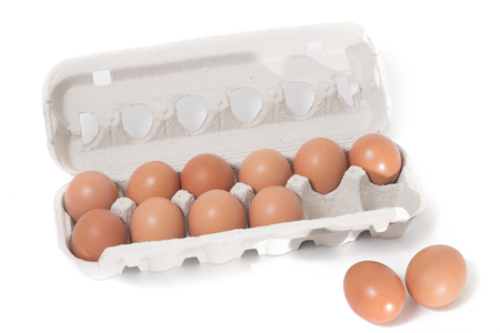 eggs inside cardboard package isolated on a white background.