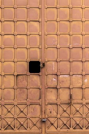 Close up view of a brown old rusty metal door. Banco de Imagens