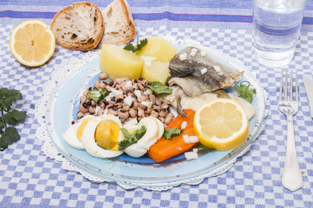Traditional portuguese meal of cowpeas with cod fish, potato and egg.