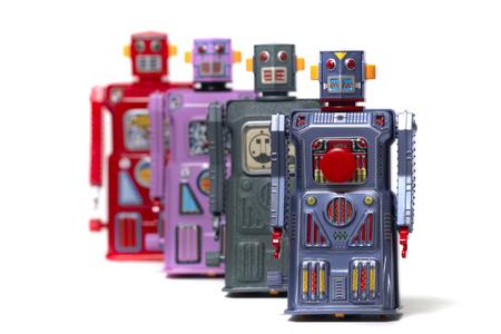 Vintage tin robot toys isolated on a white background.