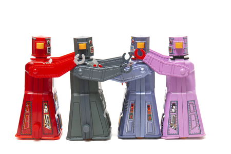 Vintage tin robot toys holding together on a row. Stock Photo
