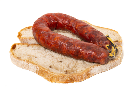 chorizo and traditional bread slices isolated on a white background.