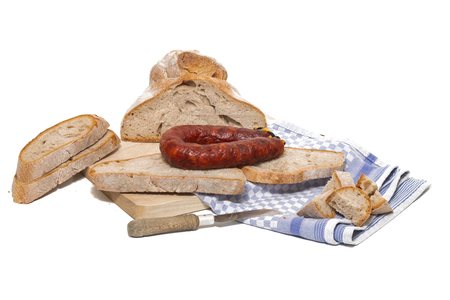 chorizo and traditional bread slices isolated on a white background. Stock Photo