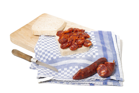 chorizo and traditional bread slices isolated on a white background. Imagens