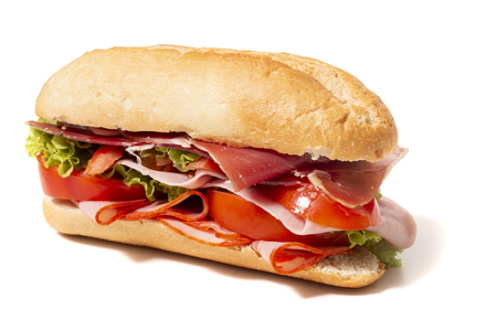 sandwich with paio sausage and ham over a white background.
