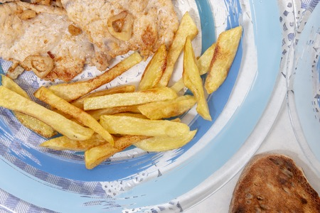 Traditional portuguese meal of Turkey steak with french fries.
