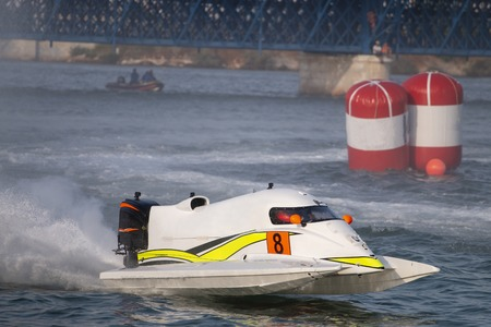 Fast powerboat racing on a river in Portimao, Portugal. Фото со стока