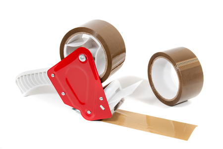 Brown adhesive packaging tape dispenser isolated on a white background.