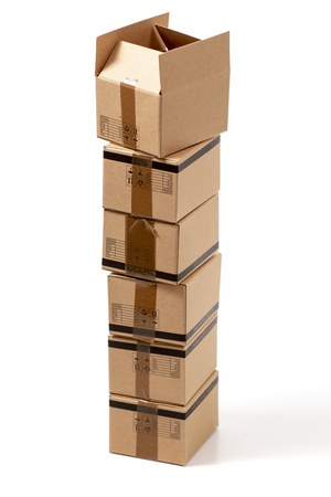 Classic cardboard boxes isolated over a white background. 写真素材