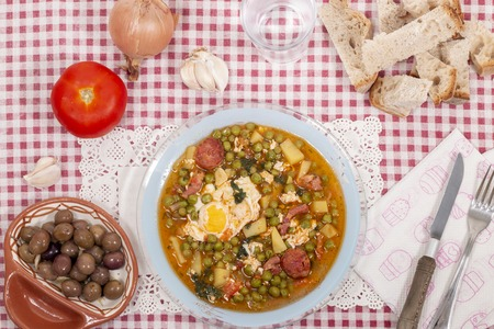 Traditional portuguese culinary meal of green peas with egg, potatoes and chorizo.