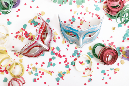 carnival venetian masks with confetti isolated on a white background. Stock Photo